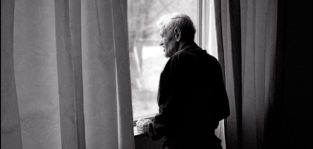 My grandfather, Charles Crawford, looking out the window of his house.